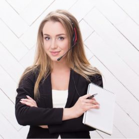 Business people. Woman with blonde hair and headset